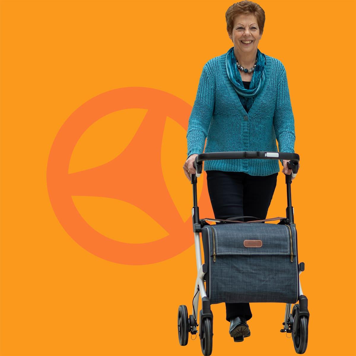 Woman walking with a Rollz Flex rollator with big shopping bag