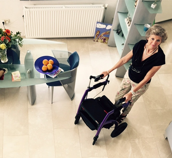 Woman using a Rollz Motion stable rollator inside her house