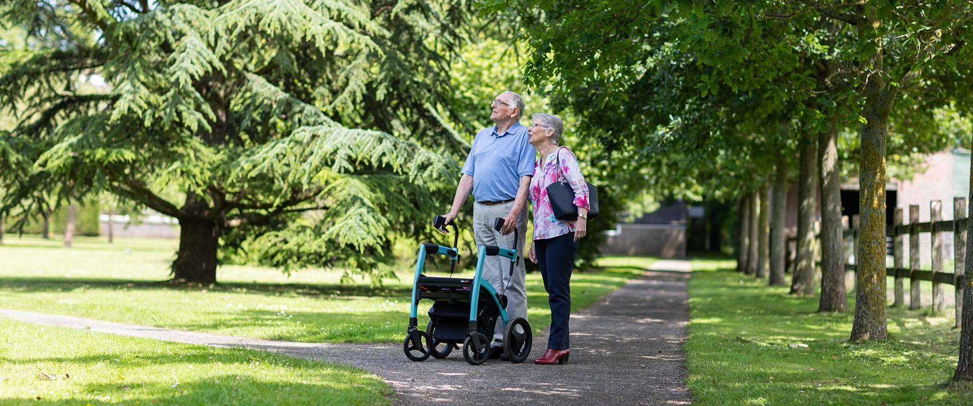 Couple enjoying a day out as one of them uses a Rollz Motion rollator and wheelchair